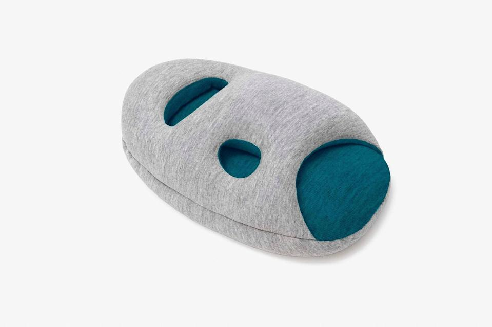 """This two-in-one mini OstrichPillow is a gift that looks funny but comes in handy. Whether you're at your desk, relaxing at home, or sitting on a train, this pillow allows you to take a nap in pretty much any position. It's created with polystyrene microbeads that make it super soft, and includes multiple hand openings so you can place it exactly where you want it (on your elbow, arm, or hand). Plus, its compact size allows for easy packing, making it a suitable gift for workaholics who don't usually have spare space in their work desks. $40, Amazon. <a href=""""https://www.amazon.com/OSTRICH-PILLOW-Travel-Airplane-Support/dp/B06Y44DZC4"""" rel=""""nofollow noopener"""" target=""""_blank"""" data-ylk=""""slk:Get it now!"""" class=""""link rapid-noclick-resp"""">Get it now!</a>"""