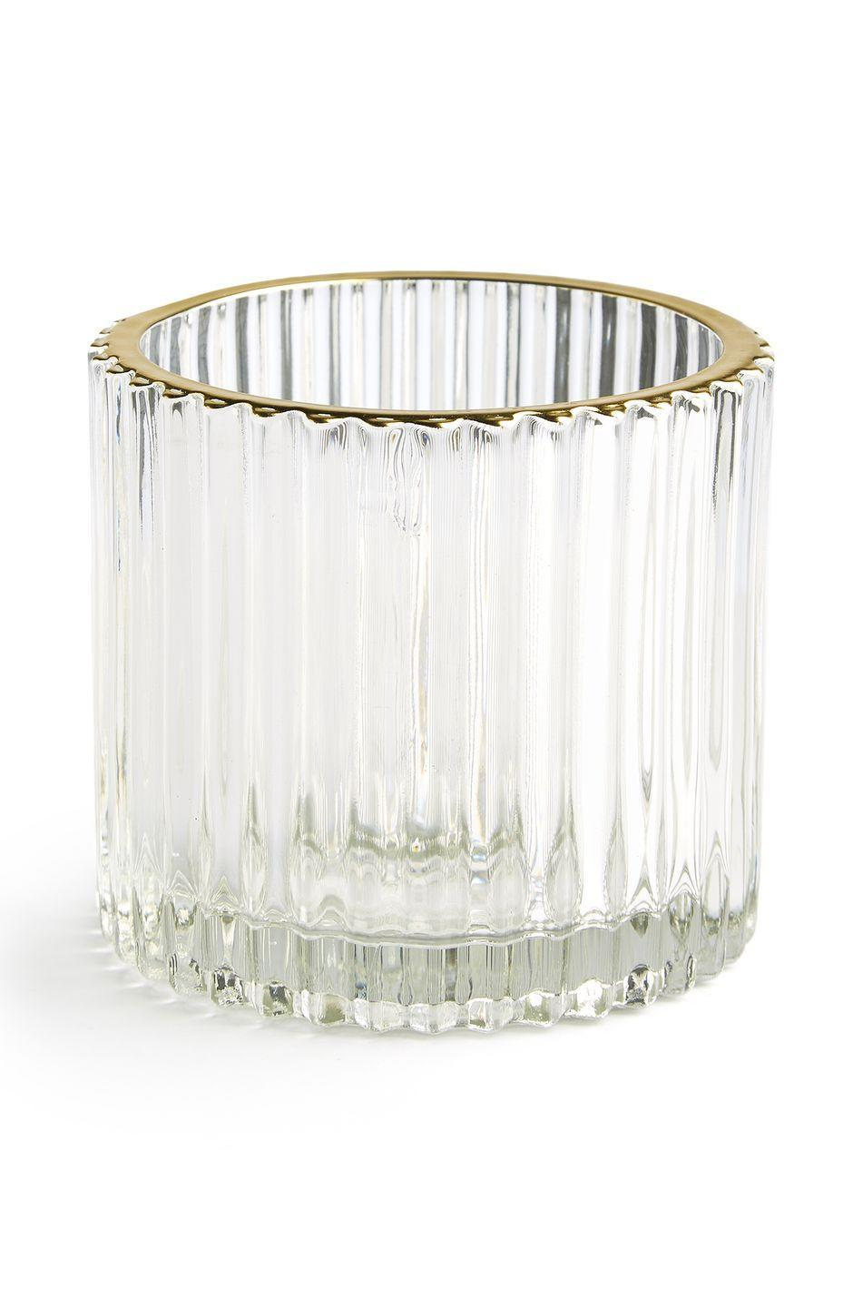 <p>Ribbed glass candle holder, £2.00 </p>