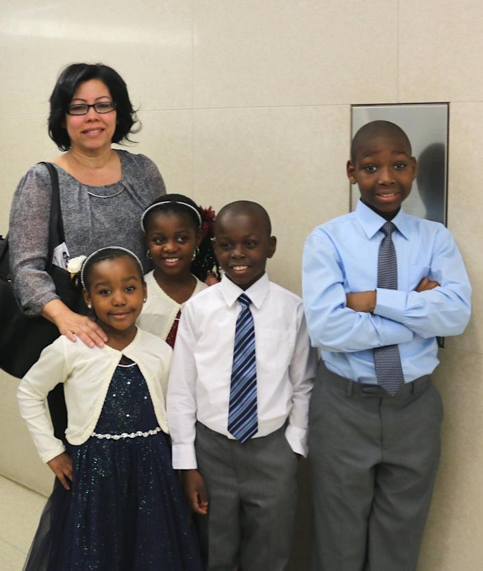 """""""At Kings County Family Court in Brooklyn, NY, with the help of<a href=""""https://www.nyfoundling.org/"""" target=""""_blank"""">The New York Foundling</a>, Ms. Mayra Rivera adopted four siblings all at once to ensure that they could remain together as a family under one roof. Ms. Rivera has been a foster parent for six years, and on Nov. 16, she adopted Shawn, William, Rosa and Na Maya. Ms. Rivera, who runs a day care center from her home, said, 'It was a situation that was just supposed to be for a few months, but after a few years, I felt that they were already mine, so I wanted to adopt them to give them a good home.'"""""""