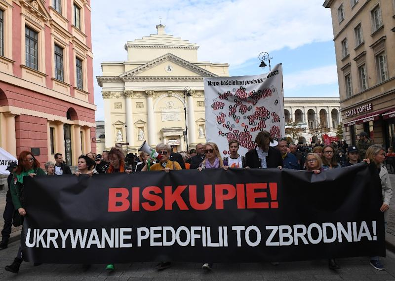 "Protesters hold a banner reading ""Bishop, Hiding Pedophilia is a Crime"" during a demonstration against alleged child sex abuse in the Catholic Church in Warsaw on October 7, 2018"