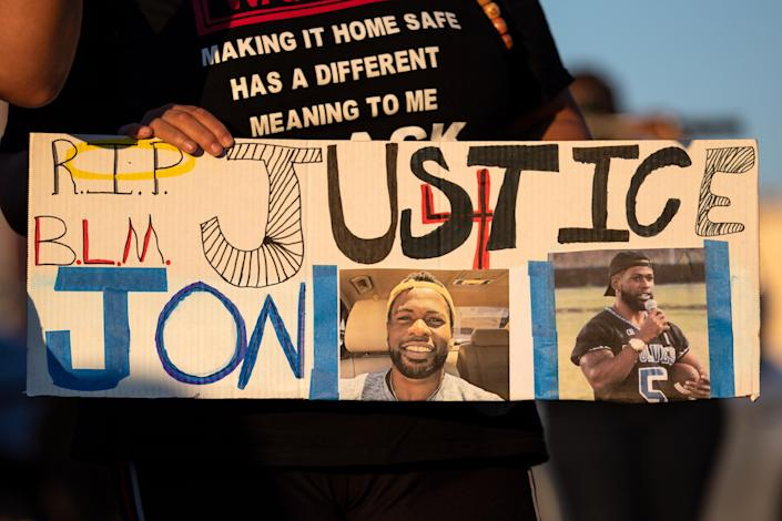 """A sign reading """"Justice 4 Jon"""" at a candlelight vigil for Jonathan Price. (Montinique Monroe/Getty Images)"""
