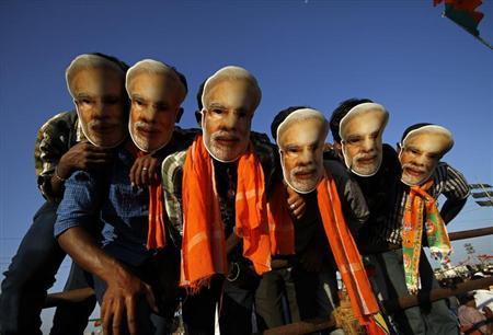Supporters of Hindu nationalist Narendra Modi wear masks during a rally in Chennai