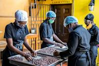 Workers at Makaya, a chocolate company in Petionville, Haiti, sort cocoa beans