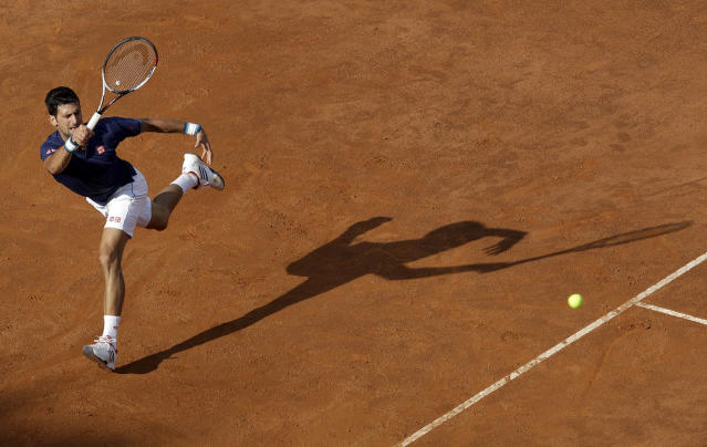 <p>Novak Djokovic returns the ball to Britain's Aljaz Bedene, during the Italian Open tennis tournament, in Rome, Tuesday, May 16, 2017. (Photo: Andrew Medichini/AP) </p>