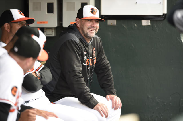 FILE - In this Tuesday, April 9, 2019 file photo, Baltimore Orioles manager Brandon Hyde sits in the dugout before playing the Oakland Athletics in a baseball game in Baltimore. There might come a time when Brandon Hyde wakes up in the morning, grabs a newspaper and checks out the standings to see where the Baltimore Orioles stand. For now, the rookie manager simply cant bear to look. The rebuilding Orioles limped into the All-Star break with a major league worst 27-62 record. (AP Photo/Gail Burton, File)