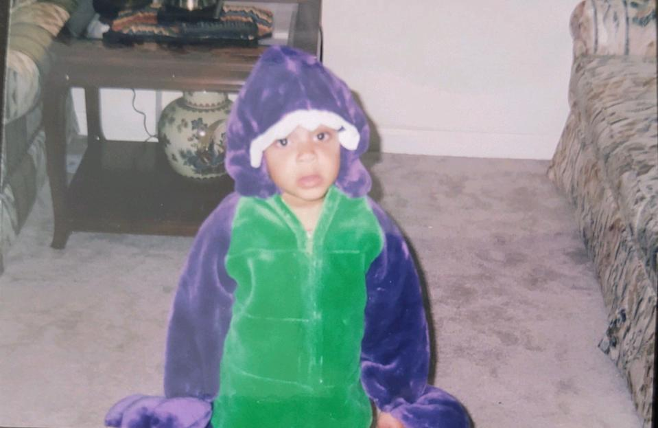 USA TODAY's N'dea Yancey-Bragg can no longer fit into this Barney costume, but still very much loves dinosaurs.