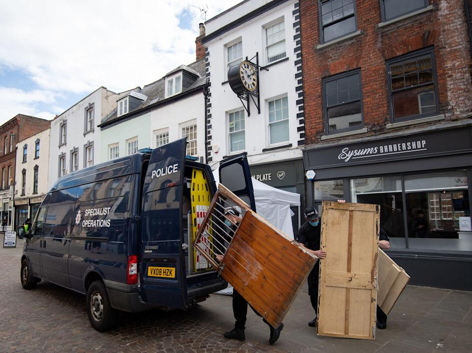 Police remove wooden doors from the Clean Plate cafe in Gloucester ahead of excavation works in the search for a suspected Fred West victimJoe Giddens/PA