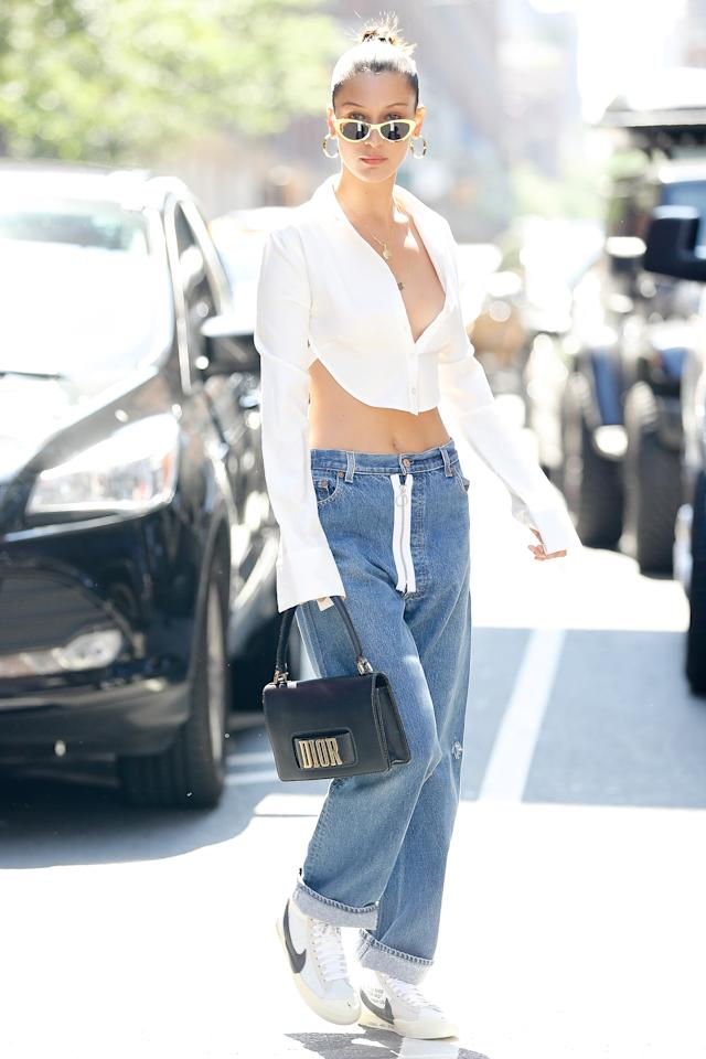 <p>In a button-down top, boyfriend jeans, Nike Cortez sneakers, cat-eye sunglasses and carrying a Dior bag while out in New York City. </p>