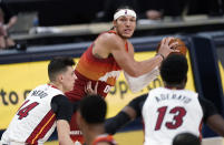 Denver Nuggets forward Aaron Gordon, back, looks to pass the ball as Miami Heat guard Tyler Herro, front left, and center Bam Adebayo defend during the first half of an NBA basketball game Wednesday, April 14, 2021, in Denver. (AP Photo/David Zalubowski)