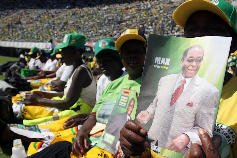 Supporters of Zimbabwean President and Zanu pf leader President Robert Mugabe are seen at his last campaign rally in Harare, Sunday, July, 28, 2013. Mugabe is set to contest against his main rival Morgan Tsvangirai in an election set for July 31.(AP Photo/Str)