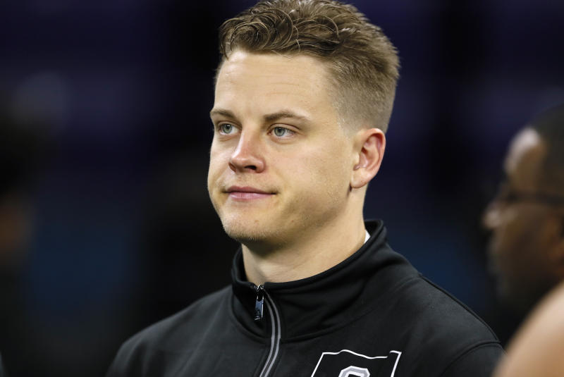 Joe Burrow said Friday that he has not yet signed his Cincinnati Bengals contract amid the coronavirus pandemic. (AP Photo/Charlie Neibergall)