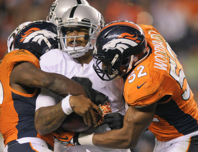 Oakland Raiders quarterback Terrelle Pryor (2) is sacked by the Denver Broncos in the fourth quarter of an NFL football game, Monday, Sept. 23, 2013, in Denver. (AP Photo/Jack Dempsey)