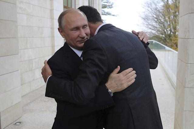 FILE PHOTO: Russian President Vladimir Putin (L) welcomes Syrian President Bashar al-Assad during a meeting in the Black Sea resort of Sochi, Russia November 20, 2017. To match Special Report RUSSIA-FLIGHTS/ Sputnik/Mikhail Klimentyev/Kremlin via REUTERS/File Photo ATTENTION EDITORS - THIS IMAGE WAS PROVIDED BY A THIRD PARTY.