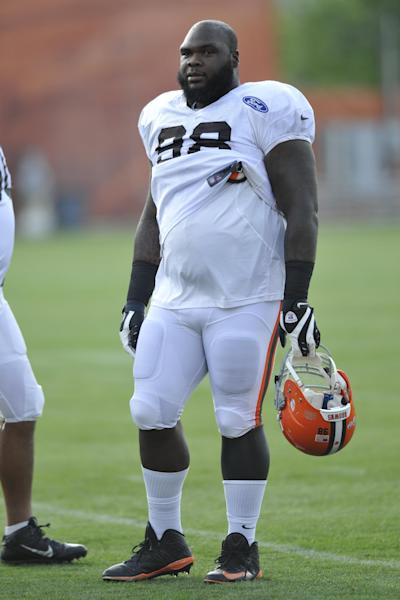 FILE - In this July 31, 2013 file photo, Cleveland Browns defensive lineman Phil Taylor looks on during NFL football training camp at the team's facility in Berea, Ohio. The last time the Browns and Baltirmore Ravens got together in September, Taylor accused Ravens running back Ray Rice of spitting in his face. Tensions have cooled, but the incident hasn't been forgotten as the teams get ready to meet again this Sunday. (AP Photo/David Richard, File)