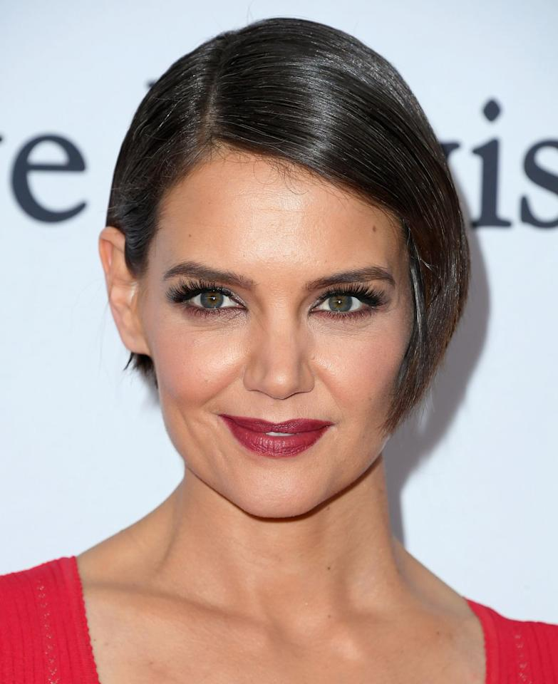 <p>This makes a dramatic statement, just like Katie Holmes did here. Show off your features or earrings that can't be missed with this polished hairstyle. Pin back your hair with bobby pins if you want to keep everything nice and tight. </p>