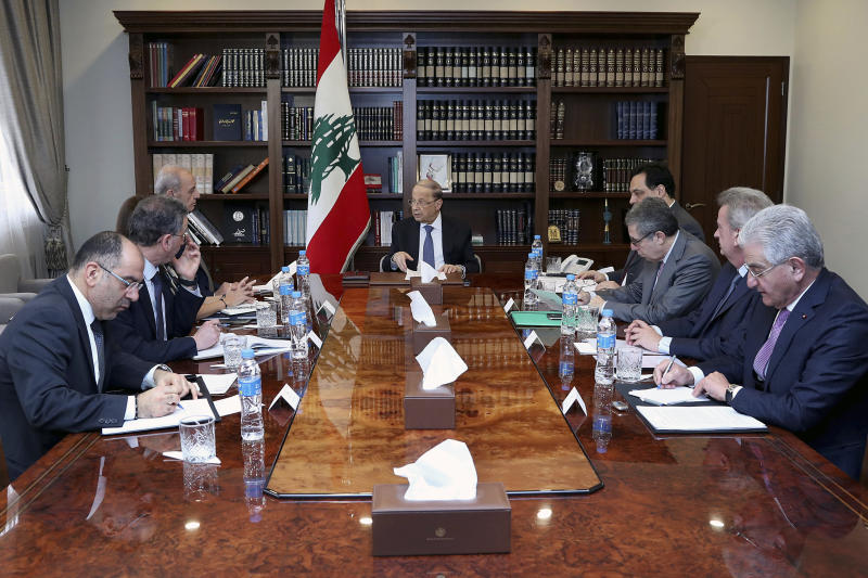 In this photo released by the Lebanese Government, Lebanese President Michel Aoun, center, meets with political and financial officials to discuss the economic situation, at the Presidential Palace in Baabda, east of Beirut, Lebanon, Thursday, Feb. 13, 2020. Finance Minister Ghazi Wazni said Thursday the new government is facing the difficult task of deciding whether to pay or default on its $1.2 billion Eurobond maturing next month. (Dalati Nohra/Lebanese Government via AP)