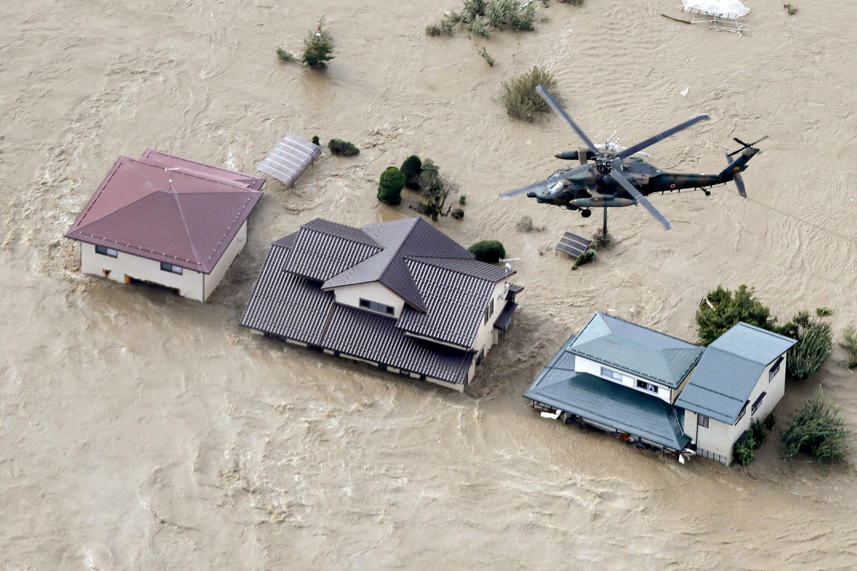 A Japan Self-Defense Forces helicopter hovers above a submerged residential area after an embankment of the Chikuma River broke because of Typhoon Hagibis, in Nagano, central Japan, Oct. 13, 2019. (Photo: Yohei Kanasashi/Kyodo News via AP)