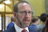 New Zealand's Health Minister Andrew Little speaks to the media at Parliament House in Wellington, New Zealand, on April 7, 2021. New Zealand announced Wednesday, April 21, 2021 it will overhaul its fragmented healthcare system to create a new national service similar to the one revered by many in Britain. Little said that over three years, the currently divided into 20 district health boards will be replaced by a single new body called Health New Zealand. (Ben McKay/AAP Image via AP)