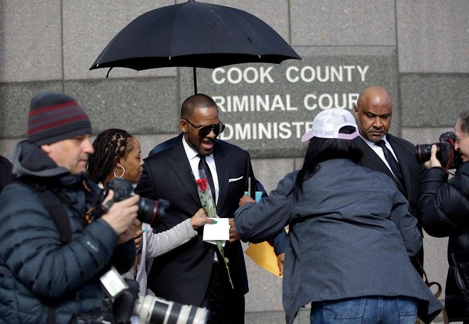 R Kelly in 2019 leaving a hearing for his sex abuse case in Chicago, Illinois (AFP via Getty Images)