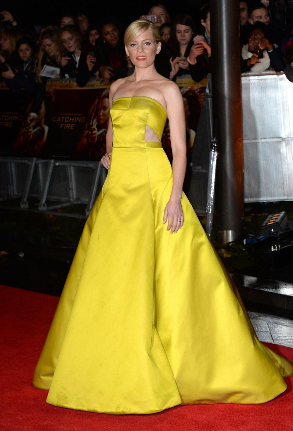 <p>While promoting 'The Hunger Games' in 2013, Elizabeth rocked a princess-worthy gown of her own. [Photo: Getty] </p>