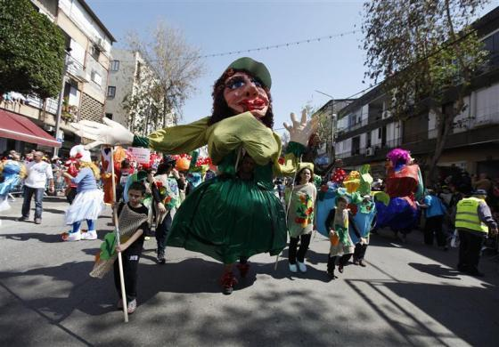 Israeli dressed in costumes take part in an annual parade for the Jewish holiday of Purim in the Israeli city of Holon, near Tel Aviv March 8, 2012.