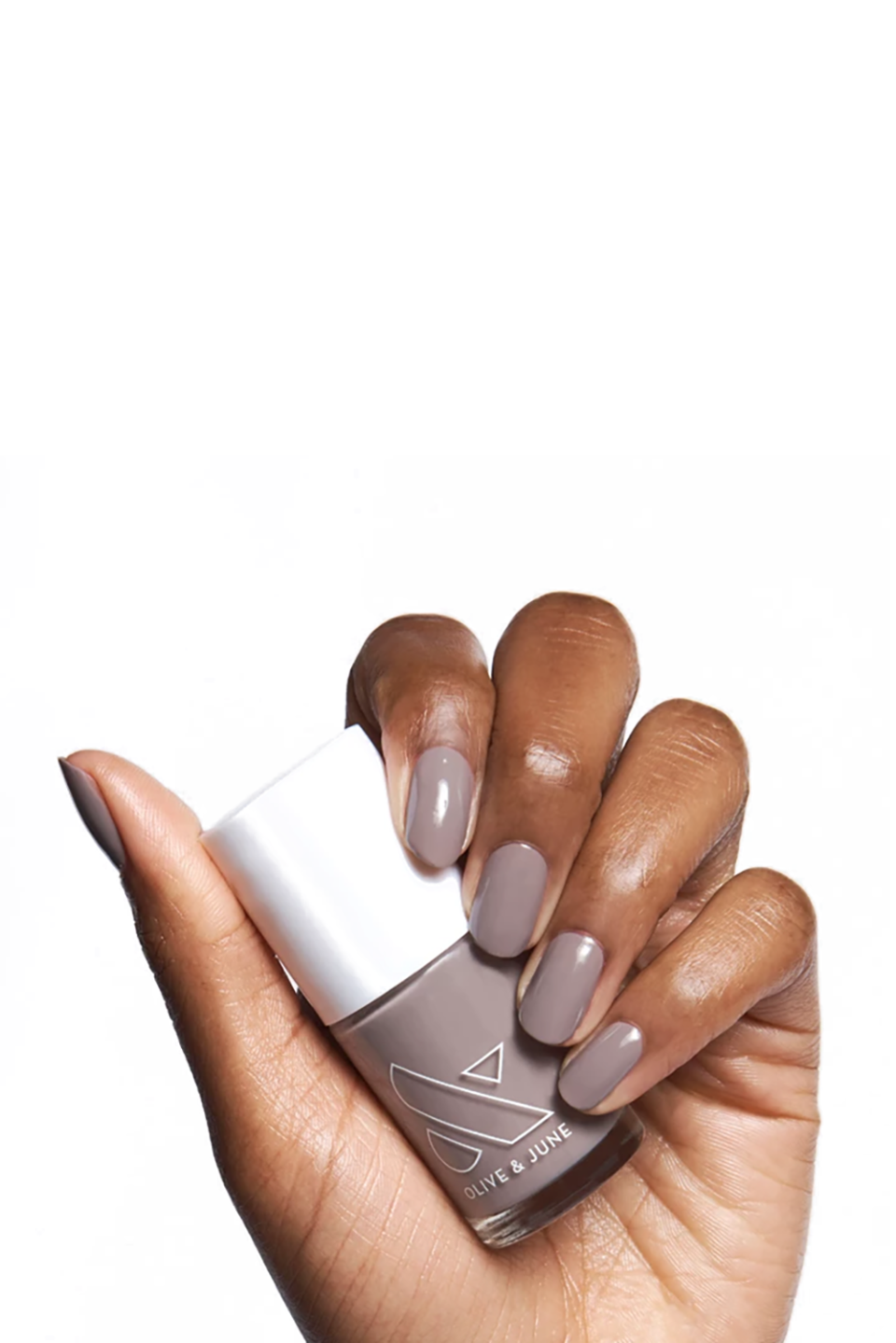 """<p><strong>Olive & June Nail Color in AW</strong></p><p>olivejune.com</p><p><strong>$8.00</strong></p><p><a href=""""https://go.redirectingat.com?id=74968X1596630&url=https%3A%2F%2Folivejune.com%2Fproducts%2Fmm&sref=https%3A%2F%2Fwww.marieclaire.com%2Fbeauty%2Fg3965%2Ffall-nail-colors%2F"""" rel=""""nofollow noopener"""" target=""""_blank"""" data-ylk=""""slk:SHOP IT"""" class=""""link rapid-noclick-resp"""">SHOP IT</a></p><p>Lean into the coolness of this season with this muted, taupe-toned grey that will look stunning on all skin tones. </p>"""