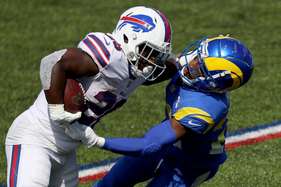 ORCHARD PARK, NEW YORK - SEPTEMBER 27: Devin Singletary #26 of the Buffalo Bills runs the ball as Troy Hill #22 of the Los Angeles Rams attempts to tackle him during the first quarter at Bills Stadium on September 27, 2020 in Orchard Park, New York. (Photo by Bryan M. Bennett/Getty Images)