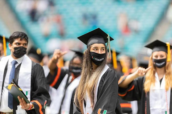Students sit at one of the commencement ceremonies of the University of Miami held at the Hard Rock Stadium in Miami Gardens on Friday, May 14, 2021.