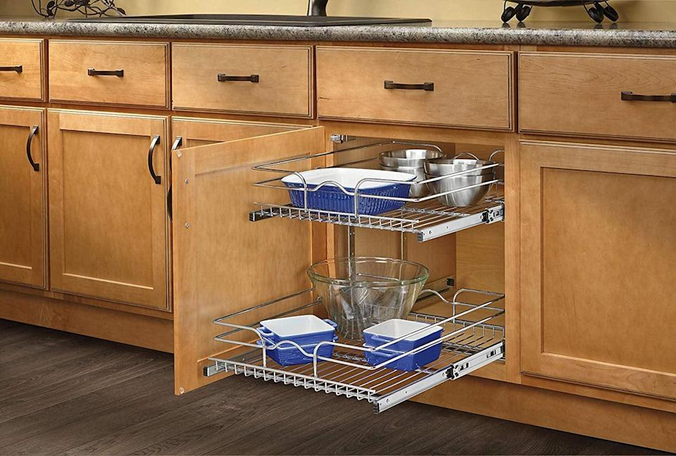 """<p>Make the most of a cupboard with this <a href=""""https://www.popsugar.com/buy/Rev--Shelf-Double-Pullout-Wire-Basket-452429?p_name=Rev-a-Shelf%20Double%20Pullout%20Wire%20Basket&retailer=amazon.com&pid=452429&price=105&evar1=savvy%3Aus&evar9=46208342&evar98=https%3A%2F%2Fwww.popsugar.com%2Fsmart-living%2Fphoto-gallery%2F46208342%2Fimage%2F46208536%2FPerfect-Under-Your-Sink&list1=shopping%2Corganization%2Ckitchen%20organization%2Ckitchens%2Csmall%20space%20living&prop13=mobile&pdata=1"""" class=""""link rapid-noclick-resp"""" rel=""""nofollow noopener"""" target=""""_blank"""" data-ylk=""""slk:Rev-a-Shelf Double Pullout Wire Basket"""">Rev-a-Shelf Double Pullout Wire Basket</a> ($105, originally $164).</p>"""