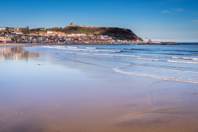 Scarborough is a town on the North Sea coast of North Yorkshire. Castle Hill separates the seafront into two bays to the North and South