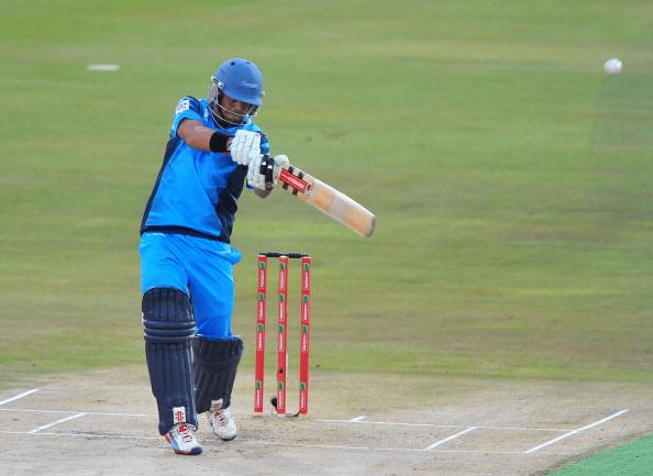 PRETORIA, SOUTH AFRICA - OCTOBER 26: (SOUTH AFRICA OUT) Jacques Rudolph of the Titans hits he ball which is then caught on the boundary for 1 run during the Karbonn Smart CLT20 semi-final match between Nashua Titans and Sydney Sixersat SuperSport Park on October 26, 2012 in Pretoria, South Africa (Photo by Duif du Toit/Gallo Images/Getty Images)