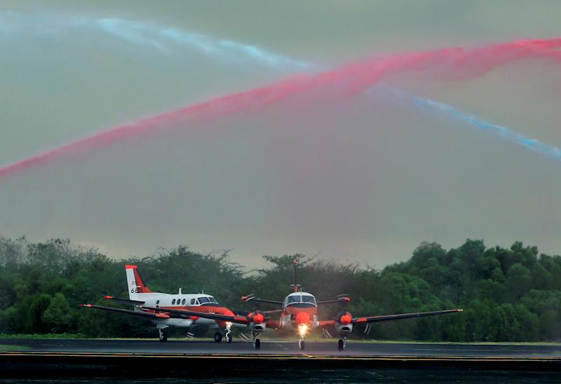 File Photo: Fire trucks spray water on two units of Beechcraft TC-90 training aircraft from Japan Ministry of Defense (JMOD) upon arrival, during a transfer ceremony of the aircrafts to the Philippine Navy at the Naval Air Group (NAG) headquarters in Sangley Point, Cavite City, Philippines March 27, 2017. (REUTERS/Romeo Ranoco)