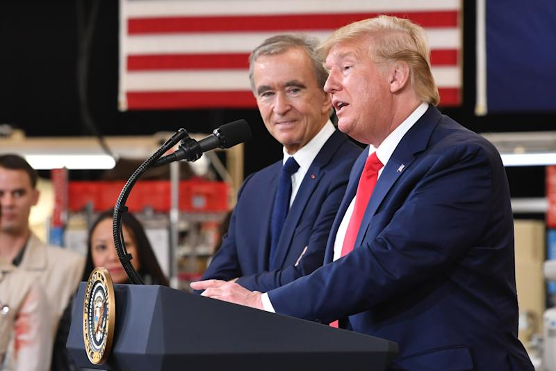Arnault and President Trump during the opening ceremony