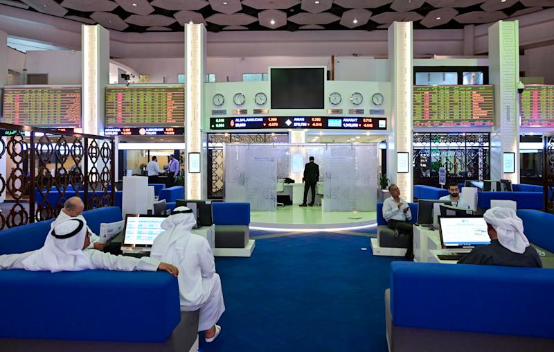 Traders follow financial markets at the Dubai Stock Exchange in the United Arab Emirates, on March 8, 2020. - Saudi's stock exchange fell 6.5 percent and other Gulf markets tumbled to multi-year lows at the start of trading after OPEC and its allies failed to clinch a deal over oil production cuts. (Photo by GIUSEPPE CACACE / AFP) (Photo by GIUSEPPE CACACE/AFP via Getty Images)