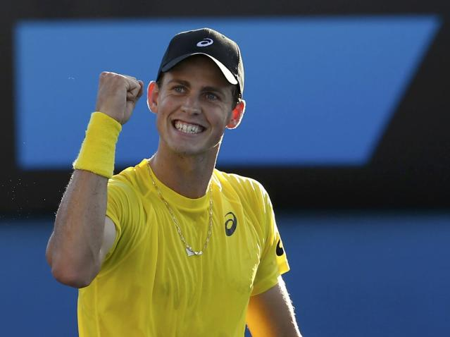 Vasek Pospisil of Canada celebrates defeating Samuel Groth of Australia during their men's singles match at the Australian Open 2014 tennis tournament in Melbourne January 13, 2014. REUTERS/Bobby Yip (AUSTRALIA - Tags: SPORT TENNIS)