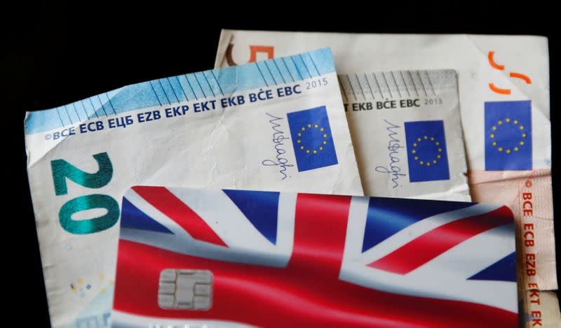 A Union Jack themed Visa credit card is seen amongst Euro bank notes in this photo illustration taken in Manchester, Britain