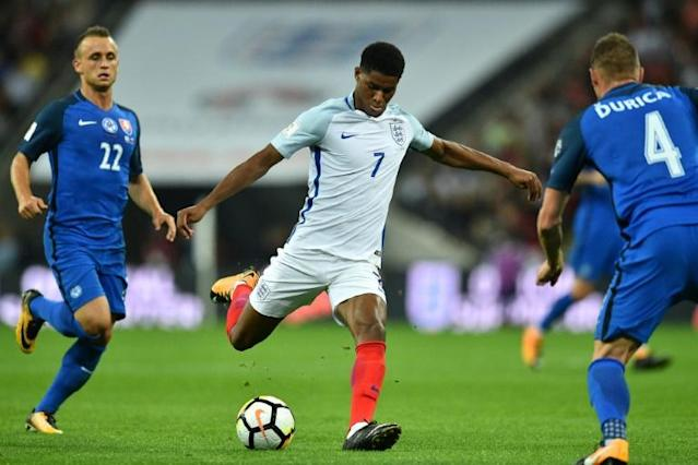 England's striker Marcus Rashford shoots to score England's second goal during the World Cup 2018 qualification football match against Slovakia September 4, 2017