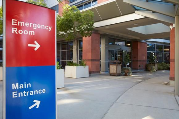Outside of hospital with emergency room and main entrance signs