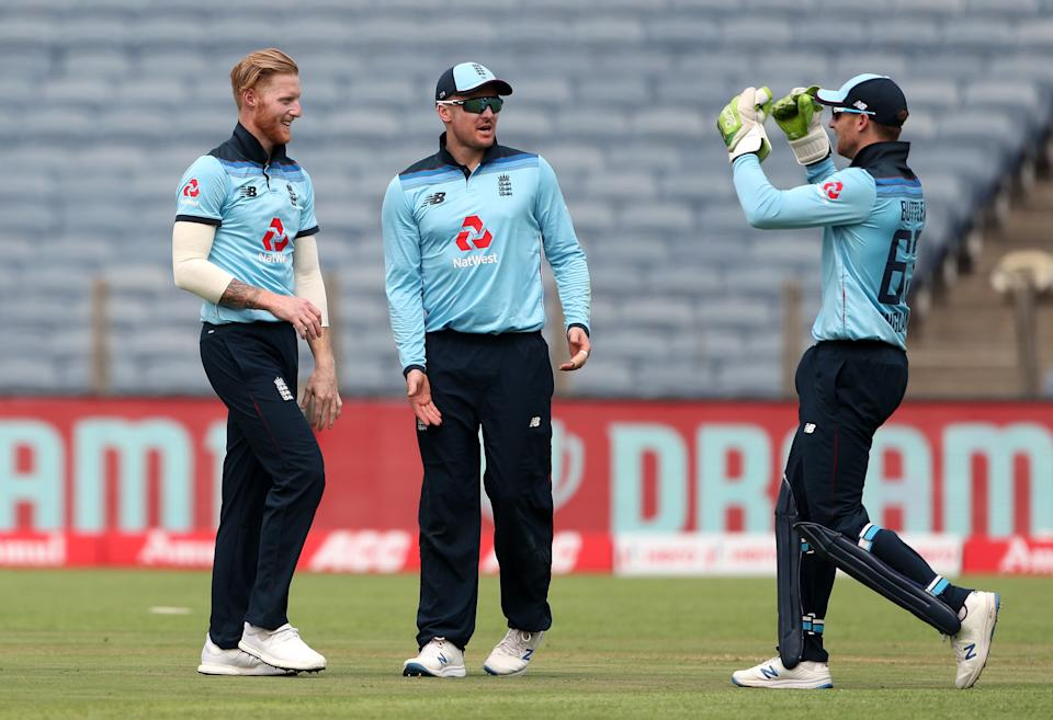 PUNE, INDIA - MARCH 23: Ben Stokes of England celebrates with Jason Roy and Jos Buttler after dismissing Rohit Sharma of India during 1st One Day International between India and England at MCA Stadium on March 23, 2021 in Pune, India. (Photo by Surjeet Yadav/Getty Images)