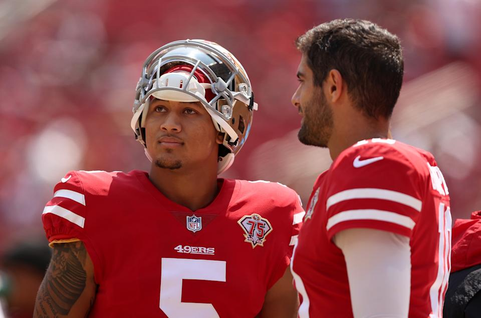 Jimmy Garoppolo #10 and Trey Lance #5 of the San Francisco 49ers