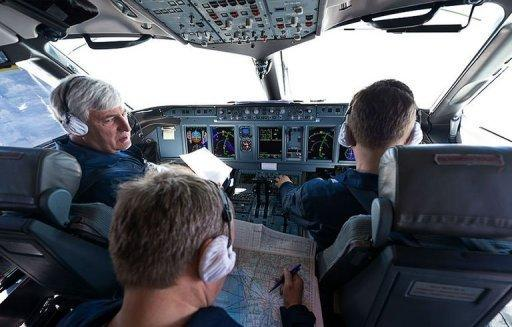 A handout photo provided by Sergey Dolya shows Russian Chief test pilot Alexander Yablontsev (L) in the cockpit of his Sukhoi Superjet 100 in Indonesia, on May 8. A Russian Sukhoi Superjet 100 with about 50 people on board went missing in a mountainous area south of the Indonesian capital Jakarta during a demonstration flight Wednesday, officials said