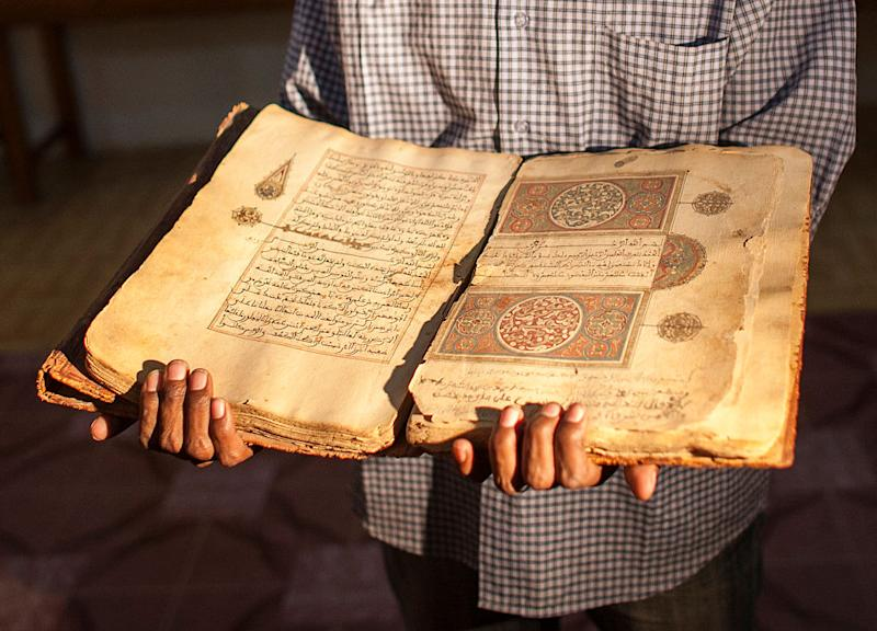 A librarian in Juma Al Majid Centre for the manuscripts conservation and restoration of Timbuktu shows one of the old manuscripts on January 19, 2010 in Timbuktu, Mali. | Andrea Borgarello—Getty Images
