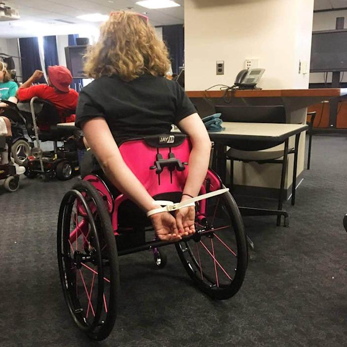 """<div class=""""inline-image__caption""""><p>Stephanie Woodward, after one of her 15 arrests by Capitol Police.</p></div> <div class=""""inline-image__credit"""">Courtesy Stephanie Woodward</div>"""