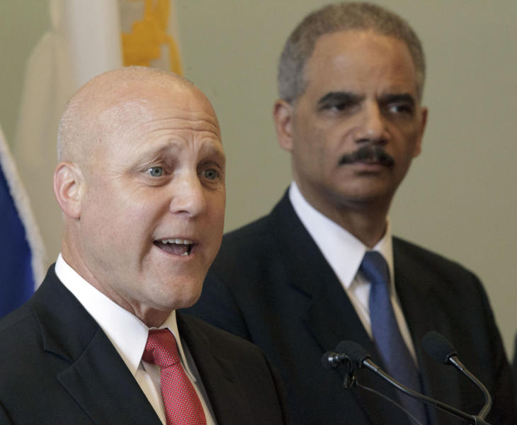 New Orleans Mayor Mitch Landrieu speaks next to U.S. Attorney General Eric Holder about the details of a federal consent decree from the U.S. Department of Justice that will be used to institute reforms in the New Orleans Police Department inside the historic Gallier Hall, the former New Orleans city hall, in New Orleans, Tuesday, July 24, 2012. (AP Photo/Matthew Hinton)