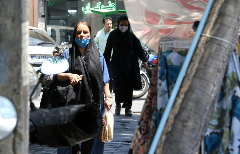 A rising virus toll has prompted authorities to make masks mandatory in enclosed public spaces and to allow the hardest-hit provinces to reimpose restrictive measures, including in the capital Tehran