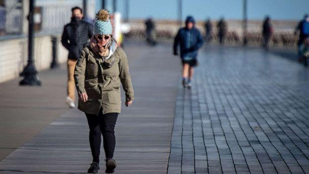 PHOTO: People brave the bitter cold weather to get some exercise by walking on the boardwalk in Long Beach, N.Y.,  Jan. 28, 2021. (J. Conrad Williams Jr./Newsday via Getty Images)