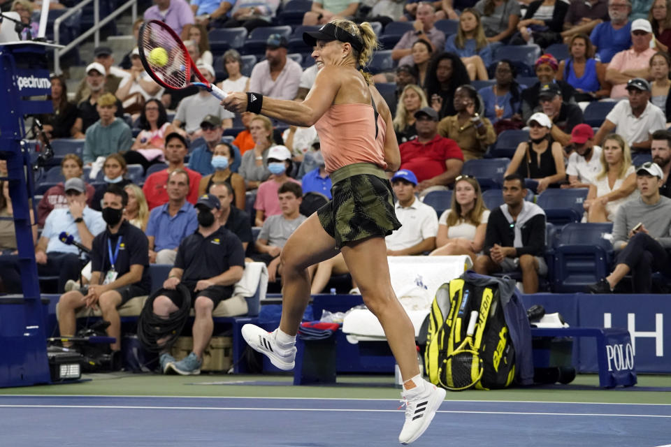 Angelique Kerber, of Germany, returns to Leylah Fernandez, of Canada, during the fourth round of the US Open tennis championships, Sunday, Sept. 5, 2021, in New York. (AP Photo/John Minchillo)