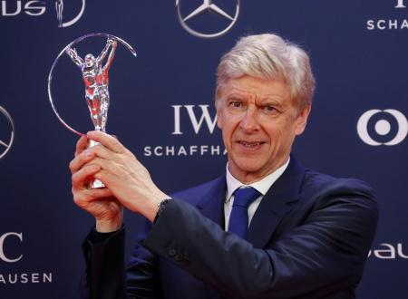 Arsene Wenger poses after winning the Lifetime Achievement Award