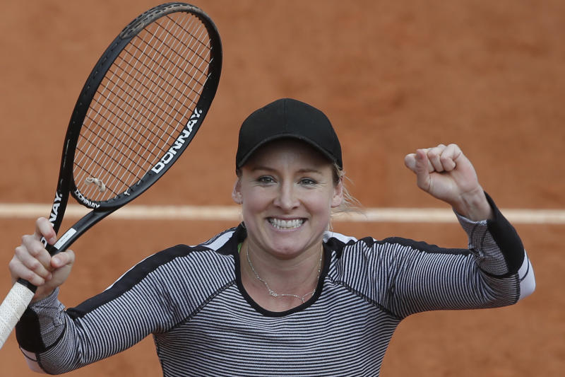 Bethanie Mattek-Sands of the U.S. celebrates defeating China's Li Na in their second round match at the French Open tennis tournament, at Roland Garros stadium in Paris, Thursday, May 30, 2013. Mattek-Sands won in three sets 6-1, 5-7, 6-4. (AP Photo/Michel Spingler)