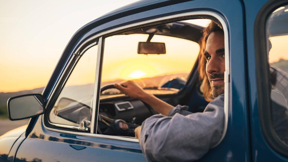 Young Couple Trip With Vintage Car.